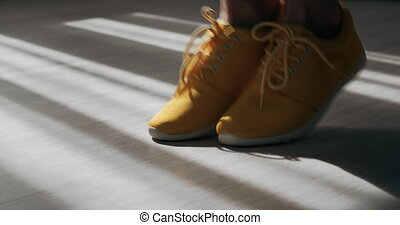 Close up of young girl in sneakers jumping with rope - Close...