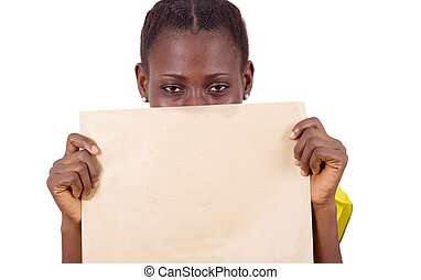 Close-up of young girl with envelope.