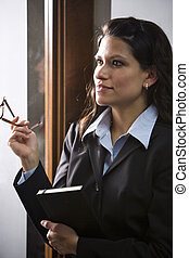 Close up of young Hispanic businesswoman