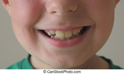 Close up of young kid smiling. Portrait of handsome boy with...