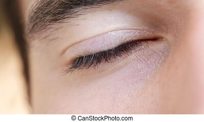 Close-up of young man eye - Close-up of young man brown...