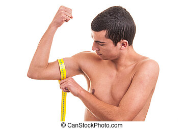 Close up of young man measuring his muscle over a white background