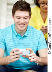 close up of young man with smartphone