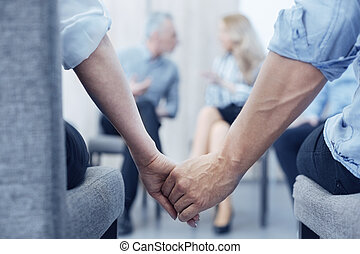 Close up of young people that holding hands