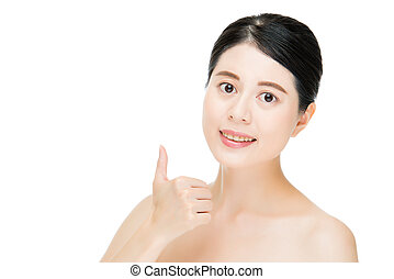 Close up of young smiling woman with finger good gesture