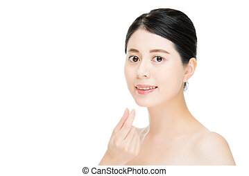 Close up of young smiling woman with hand finger gesture