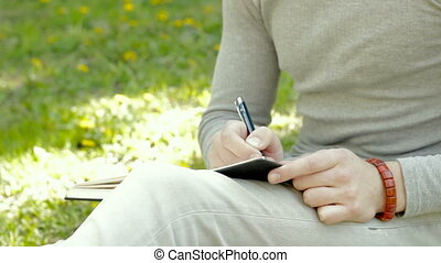 close up of young student make a notes