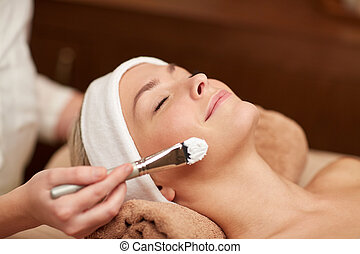 close up of young woman and cosmetologist in spa - people, ...