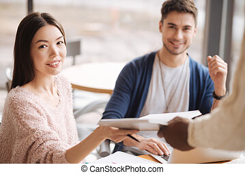 Close up of young woman getting notes
