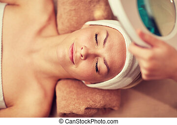 close up of young woman lying in spa - people, beauty, spa,...