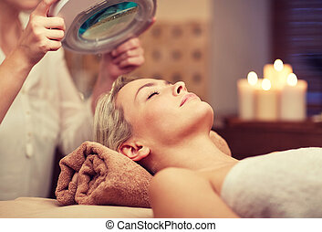 close up of young woman lying in spa - people, beauty, spa, ...