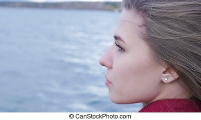 Close up of young Woman Relaxing near Lake. Romantic...