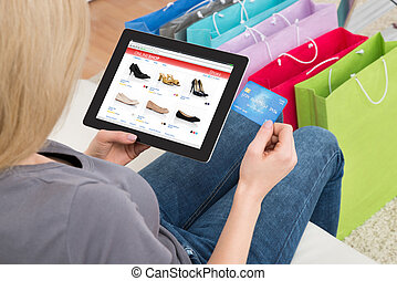 Woman Shopping Online On Digital Tablet With Credit Card