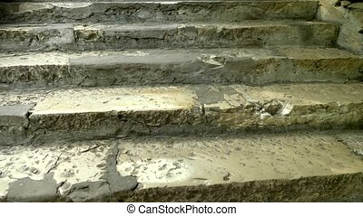 close-up. Old damaged stone staircase, upwards. textured...
