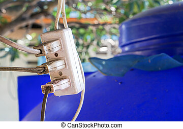 close up old electricity socket with many plugs