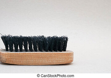close up old shoe brush in the left