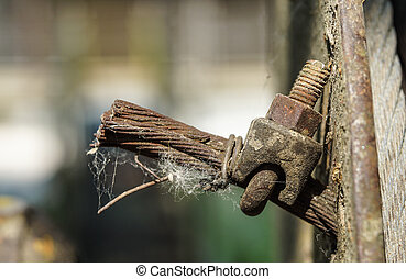 Close up old wire rope clamp and steel rope