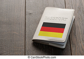 Close up on a German passport on wooden background. ...