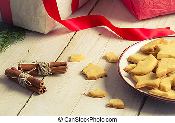 Close-up on a plate of cookies with Christmas gifts