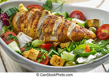 Close-up on a salad with chicken