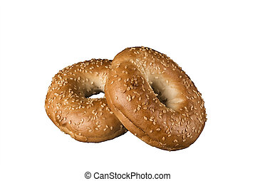 Close up on a set of bagel with sesame seeds. Isolated on white background.