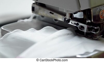 Close up on a sewing machine showing process.