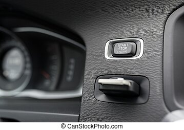 Close-up on automatic starter, start stop engine button in...