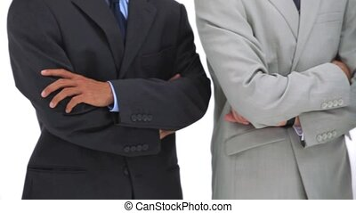 Close-up on business people arms crossed against a white...