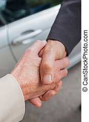 Close up on business people shaking hands