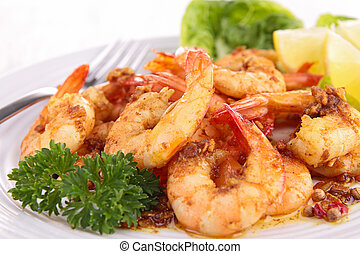 close up on cooked shrimp and parsley