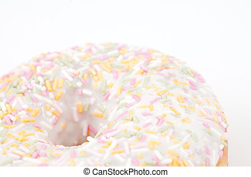 Close up on doughnut with multi coloured icing sugar