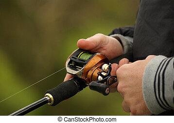 close-up on fishing reel - fishing scene - Fishing reel