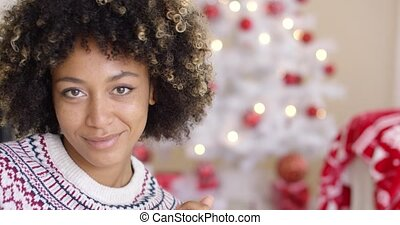 Close up on happy woman near Christmas tree - Close up on...