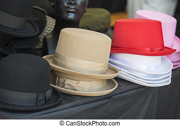 close up on  hats of felt for sale at a flea market