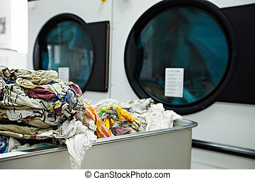 Close-up on heap of dirty laundry in laundromat - View on ...