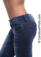 Close-up on jeans. Side view of female buttocks in jeans isolated on white
