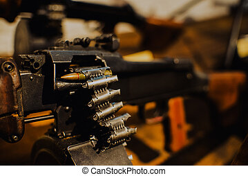 close up on last bullet in the machine gun