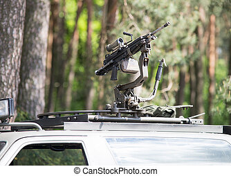 close up on machine gun in the roof of car