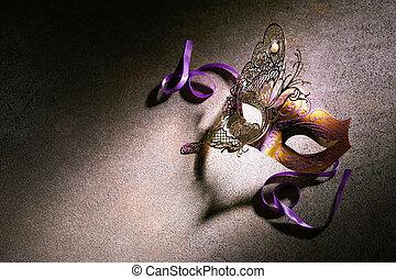 Close up on mask illuminated by bright light
