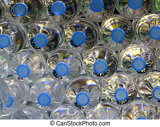 Close Up on mineral water bottles in top view