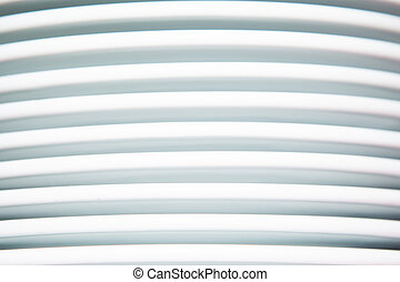 close up on pile of white plates abstract background