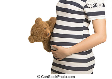 Close up on pregnant belly. Woman expecting a baby with a cute t