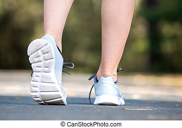 close up on running shoes fitness women training and jogging