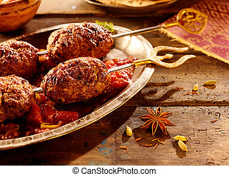 Close up on skewered meat with spices