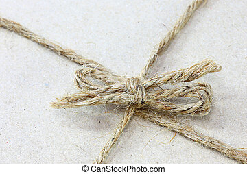 close up on String tied in a bow  brown recycled paper