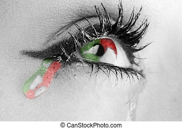 three colors tears - close up on the eyes of a young woman ...