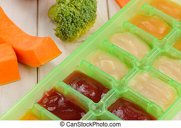 Close up on vegetables and puree in a tray container
