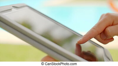 Close Up on Woman Hands While Using Tablet