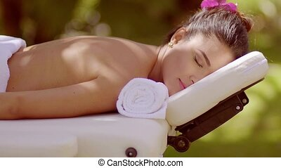 Close up on woman laying face down for massage