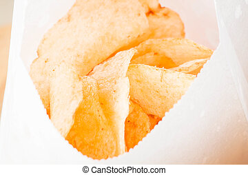 Close up opened bag of potato chips